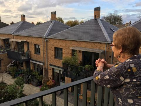 Janet looking out at the New Ground homes